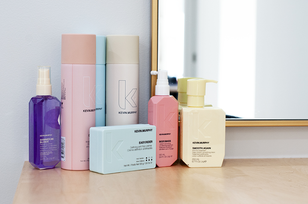 A collection of Kevin Murphy hair products on a shelf.