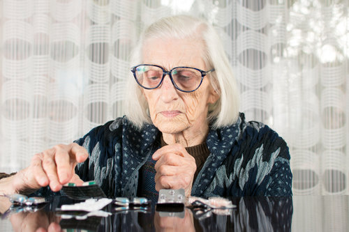 older lady sorting things on a table
