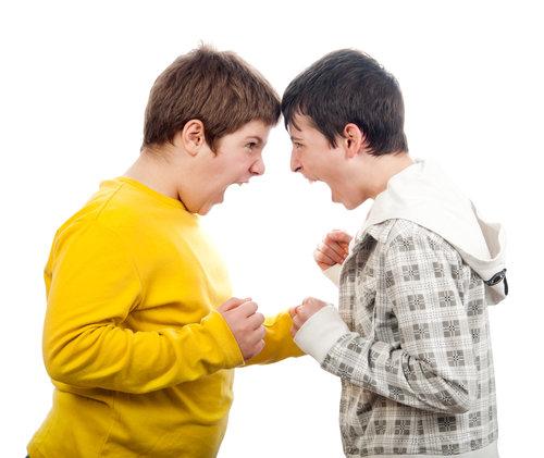 2 young teenage men arguing