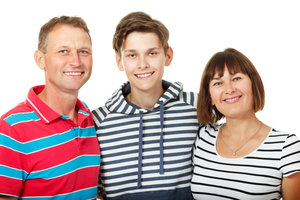 mum dad and son pose for photo