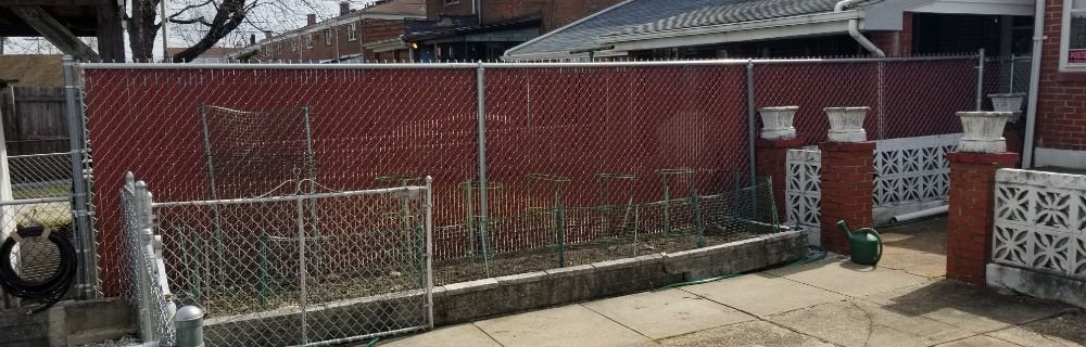 Residential 6ft Galvanized Chain Link Fence with Red Slats in Dundalk, MD