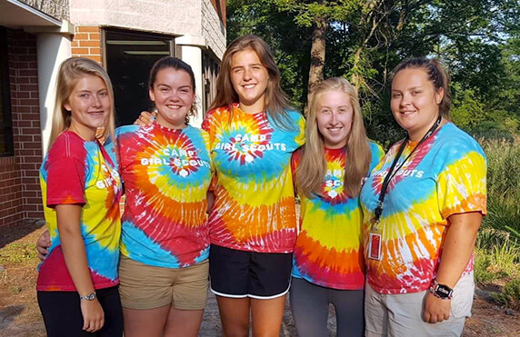 group of five camp america counsellors at a girl scouts camp