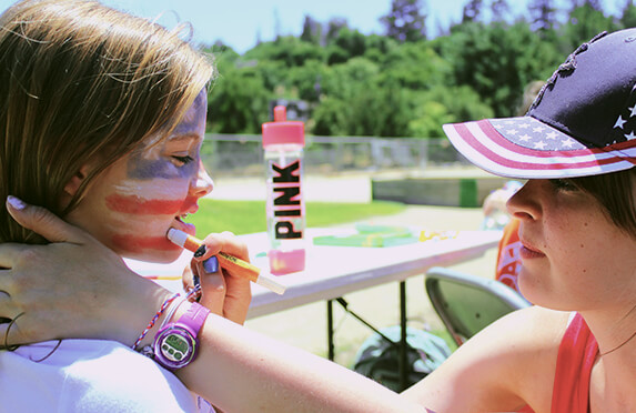 camp america counsellor painting the face of a camper
