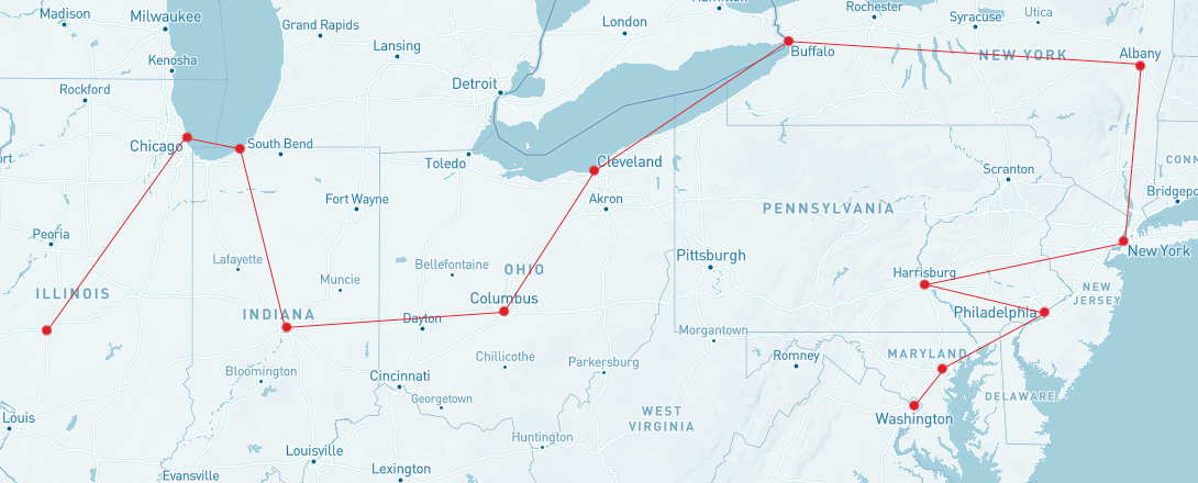A cropped map of the United States, from Illinois on the left to the Atlantic coast on the right, the bottom half of Michigan at the top, to the top half of Kentucky to the bottom. A red path is outlined to show the path of Lincoln's train journey. Main cities are highlighted: Washington DC, Baltimore, Philadelphia, Hamburg PA, New York NY, Albany NY, Buffalo NY, Cleveland OH, Columbus OH, Indianapolis, Michigan City MI, Chicago, ending in Springfield IL