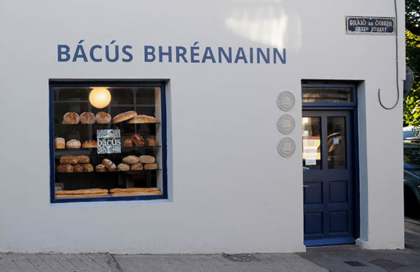 Outside view of the Bácús bakery shop on Green Street in Dingle with lots of bread in the window