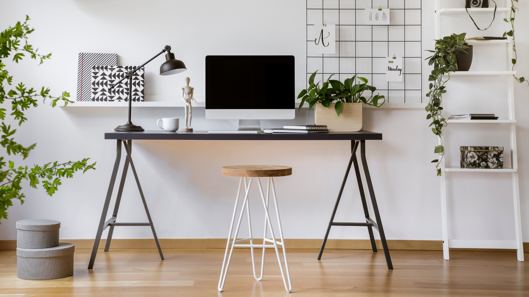 Image of trendy desk space with stool.