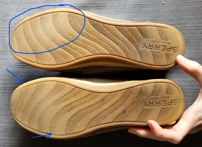 One shoe has a supinator pattern on the sole of the shoe. Bottom shoe has a more neutral wear pattern.