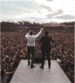 Andrey Shapoval and translator standing on stage in Ethiopia