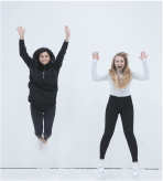 Two girls jumping in excitment