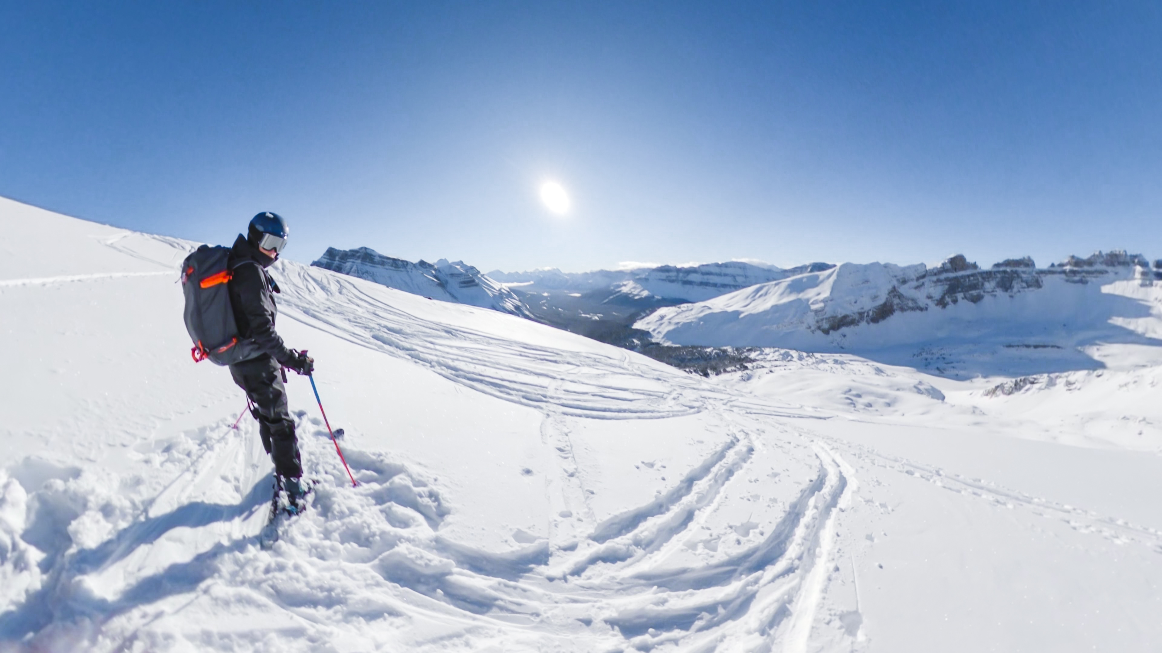 backcountry skiier at the top of oxo puzzle peak ramp