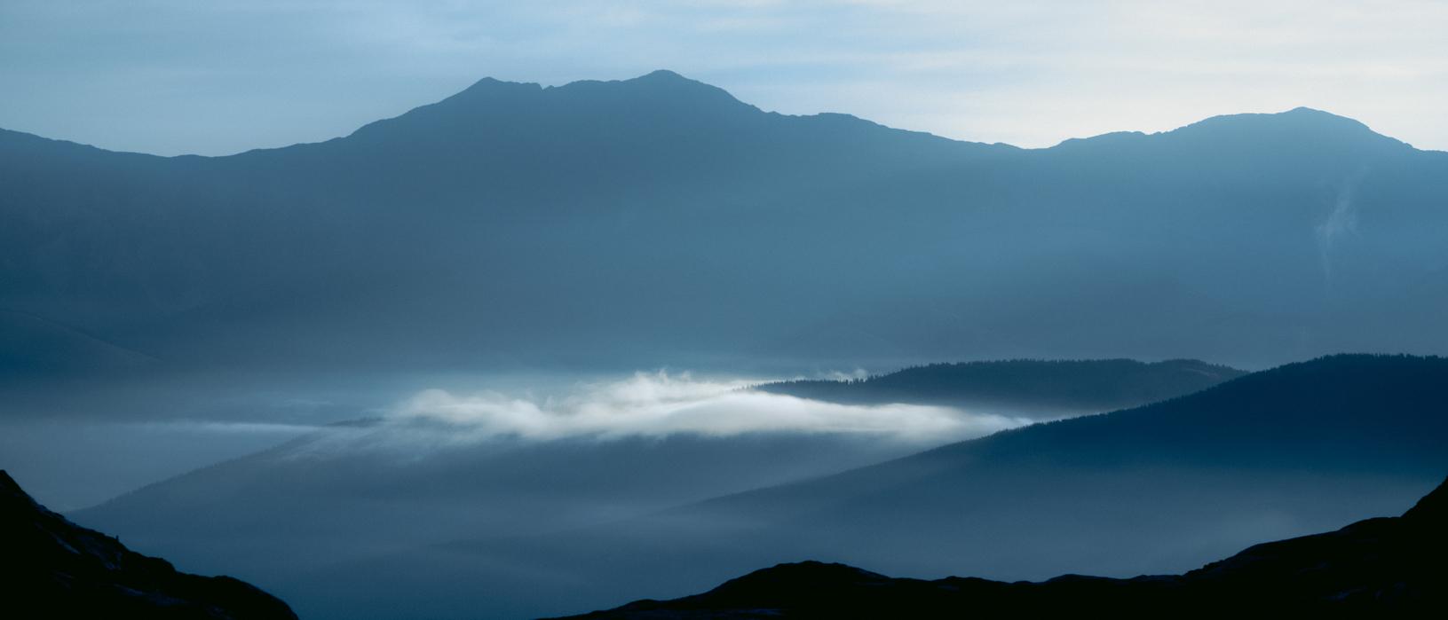 low cloud between mountain hills in kananaskis