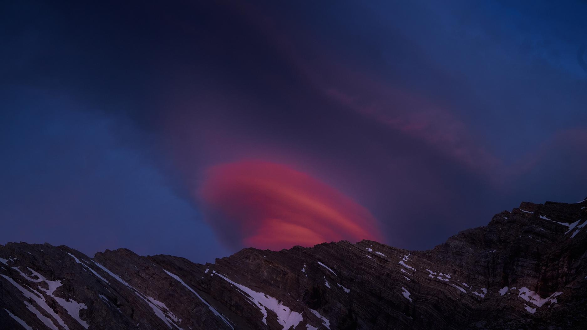 orange cloud formation at sunset above lineham ridge kananaskis