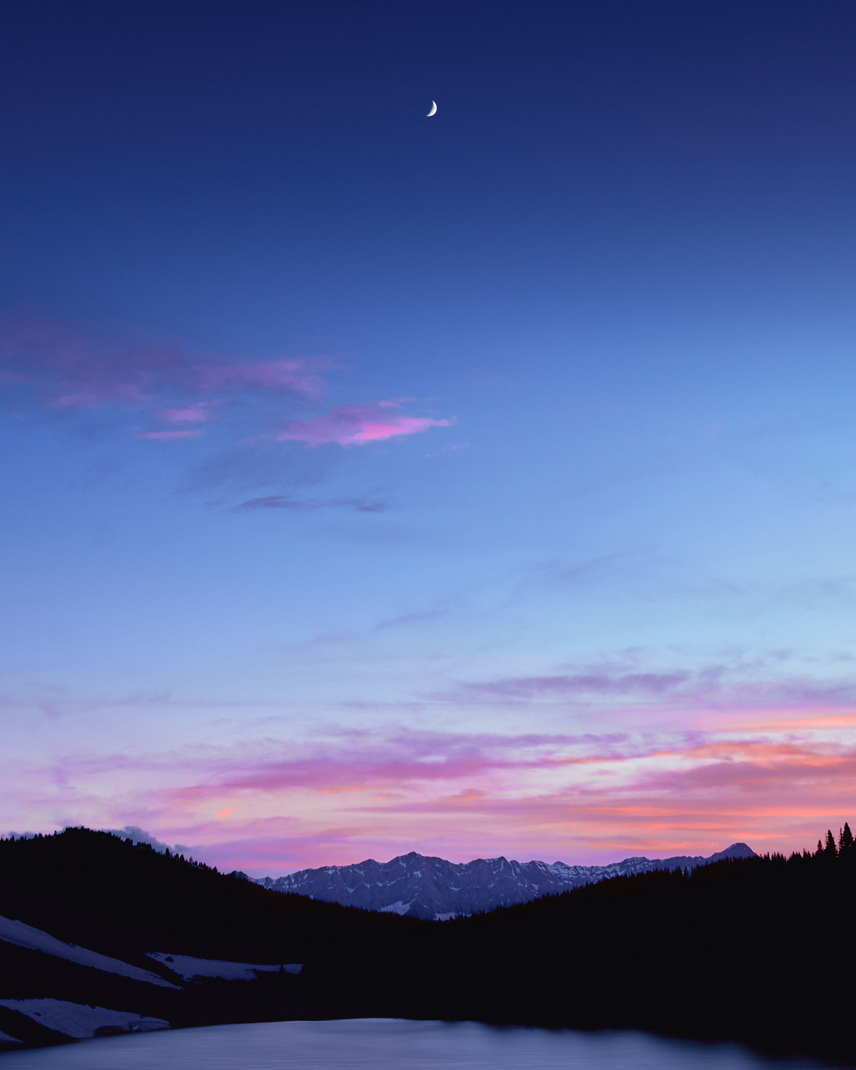 sunset over pickle jar lakes in kananskis with moon in the sky