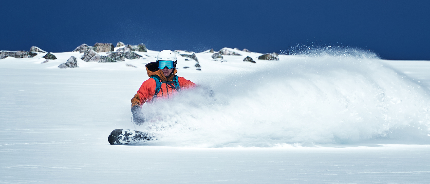 Backcountry splitboarder slashes fresh powder on route to Surprise Pass behind Lake Louise, Banff