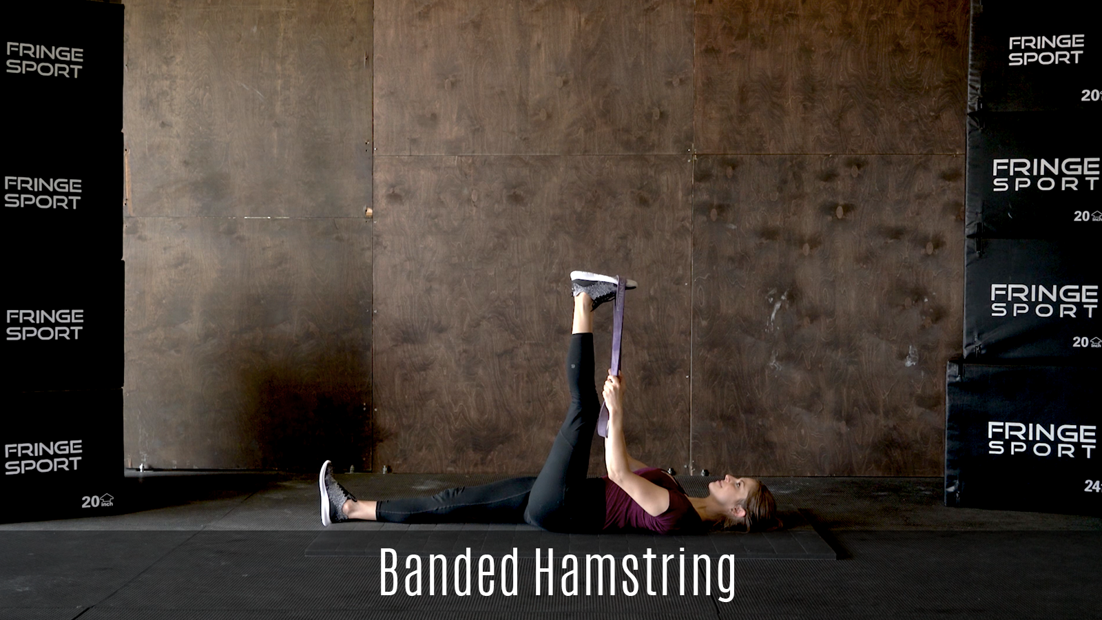 lying hamstring stretch demo using exercise band