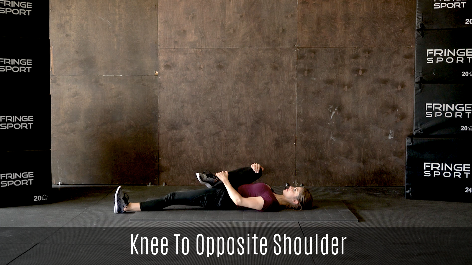 lying knee to opposite shoulder stretch