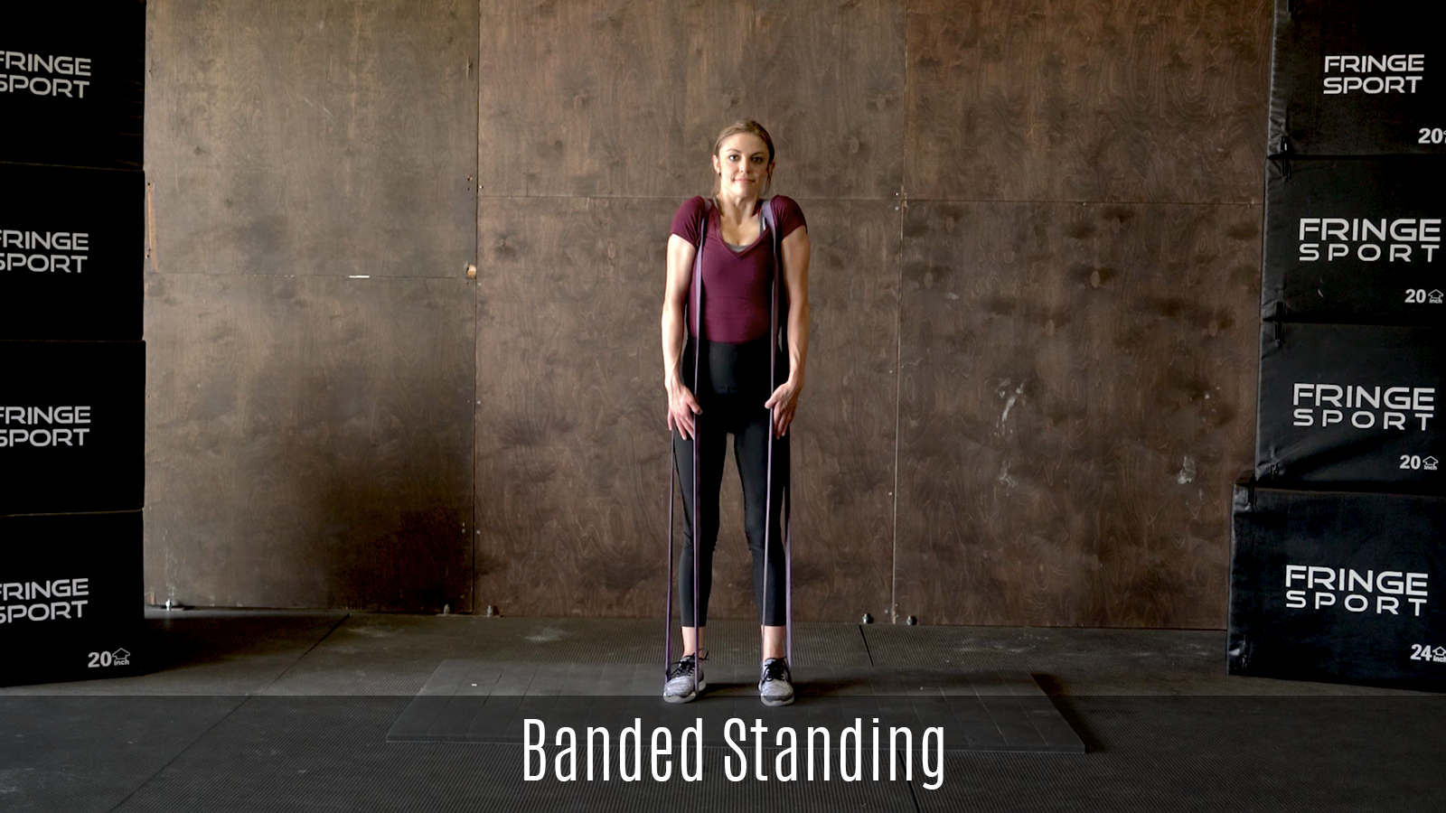 standing trap stretch demo using exercise bands