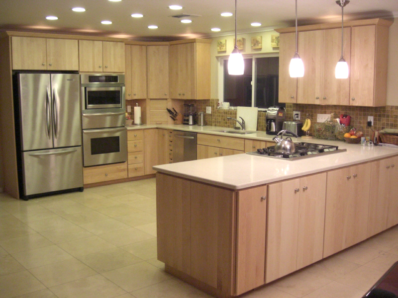 Contemporary kitchen with wood cabinets and light countertops