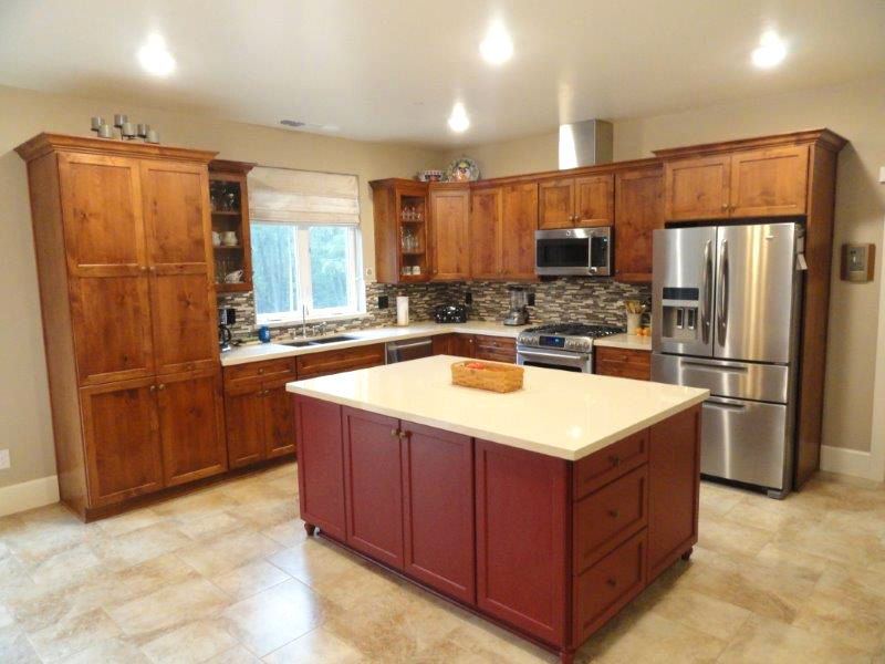 natural color cabinets and island with white countertops
