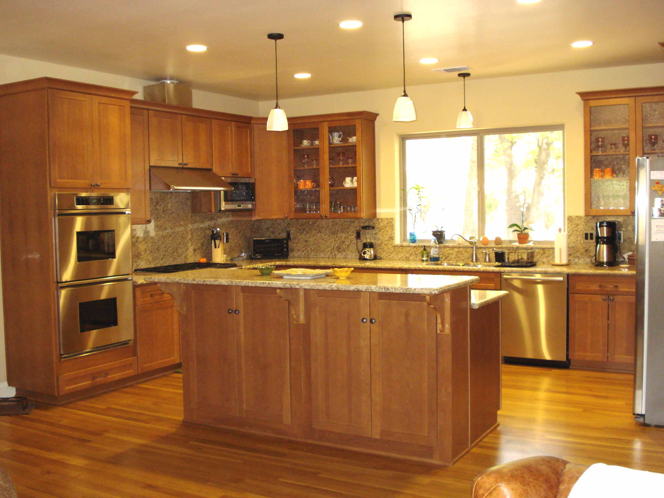 Craftsman style kitchen with light brown cabinets and cream counter tops