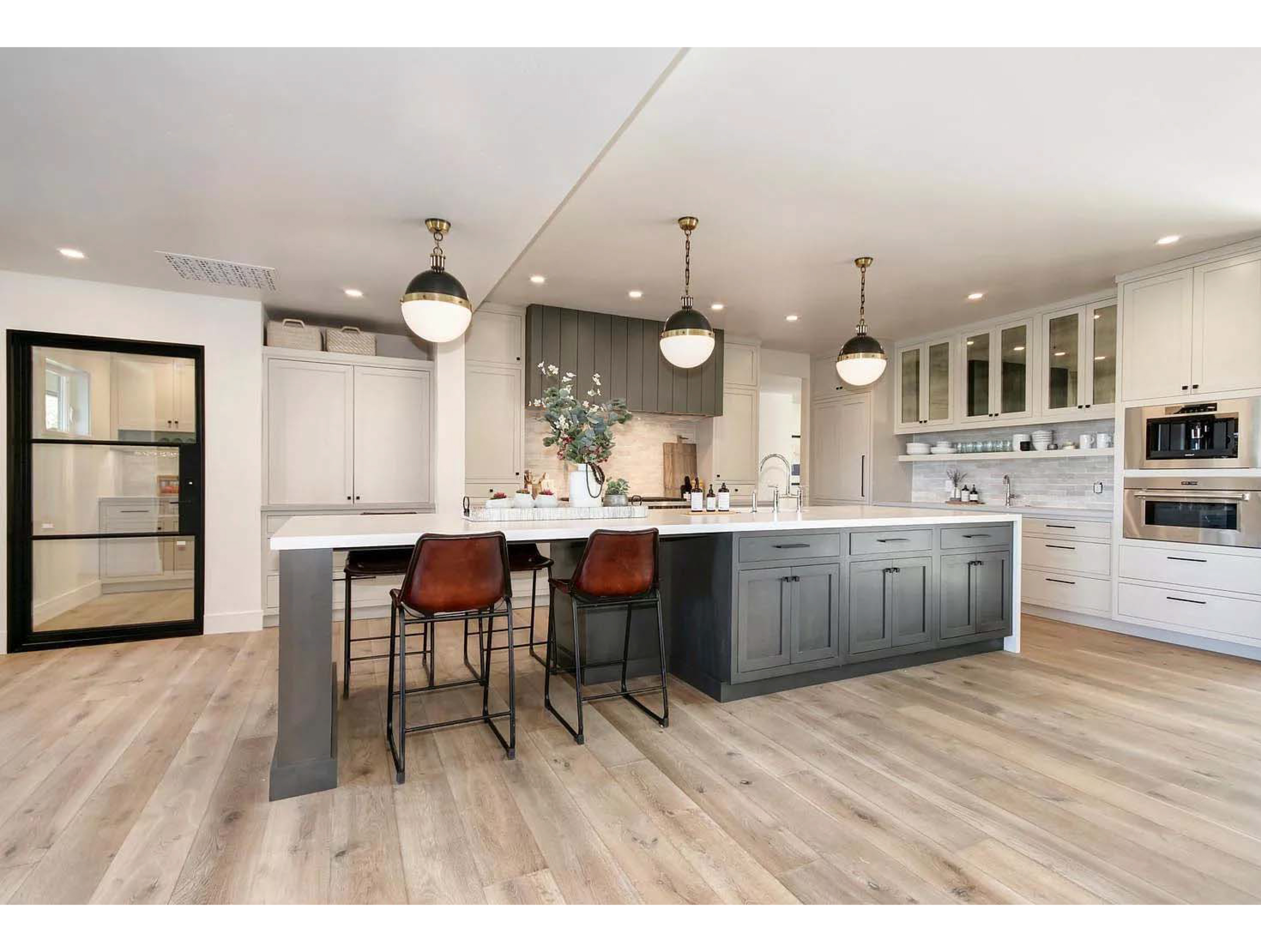 Island bar with grey cabinets and white countertop