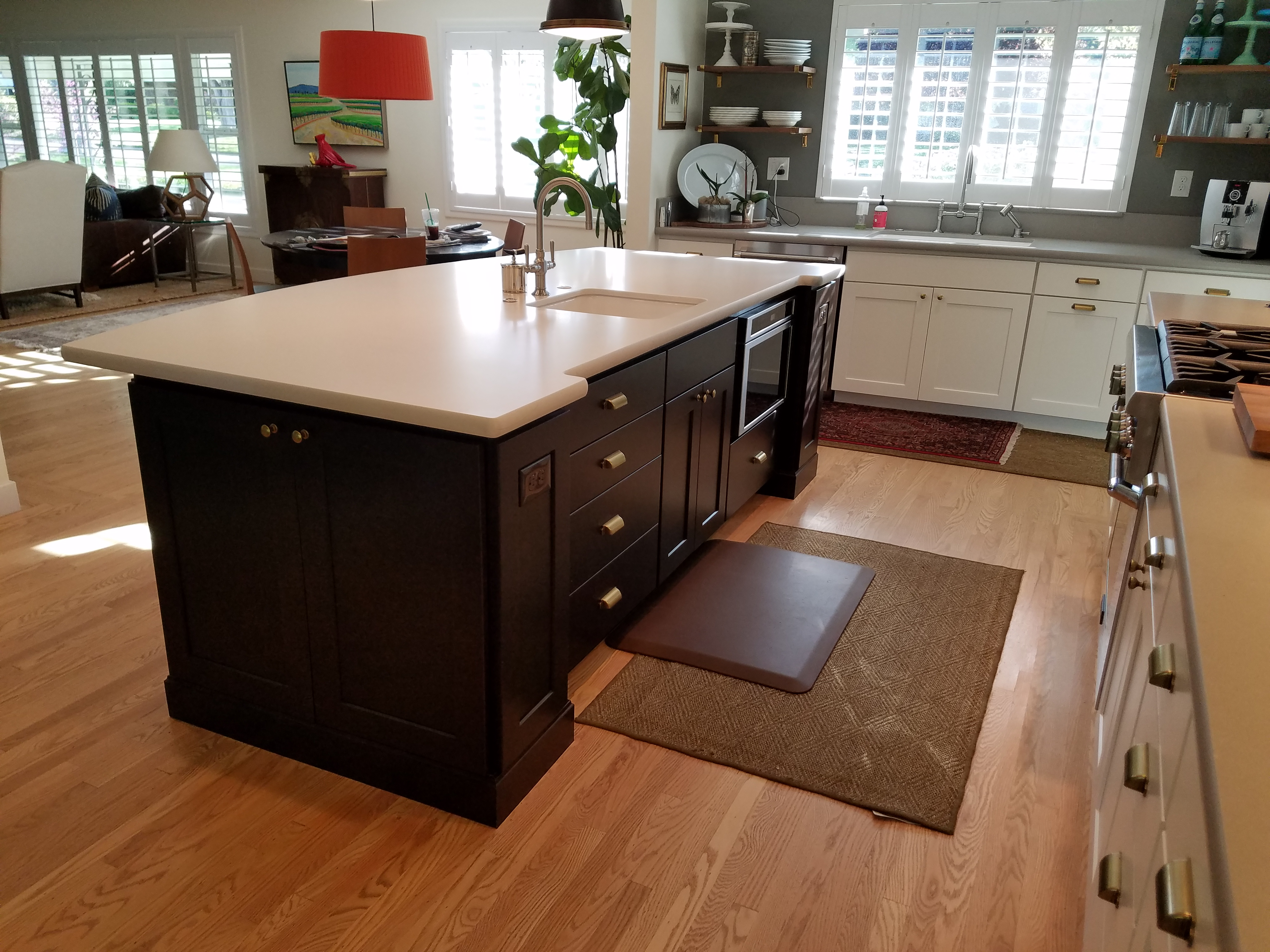 Kitchen Island with dark brown cabinets and cream countertop