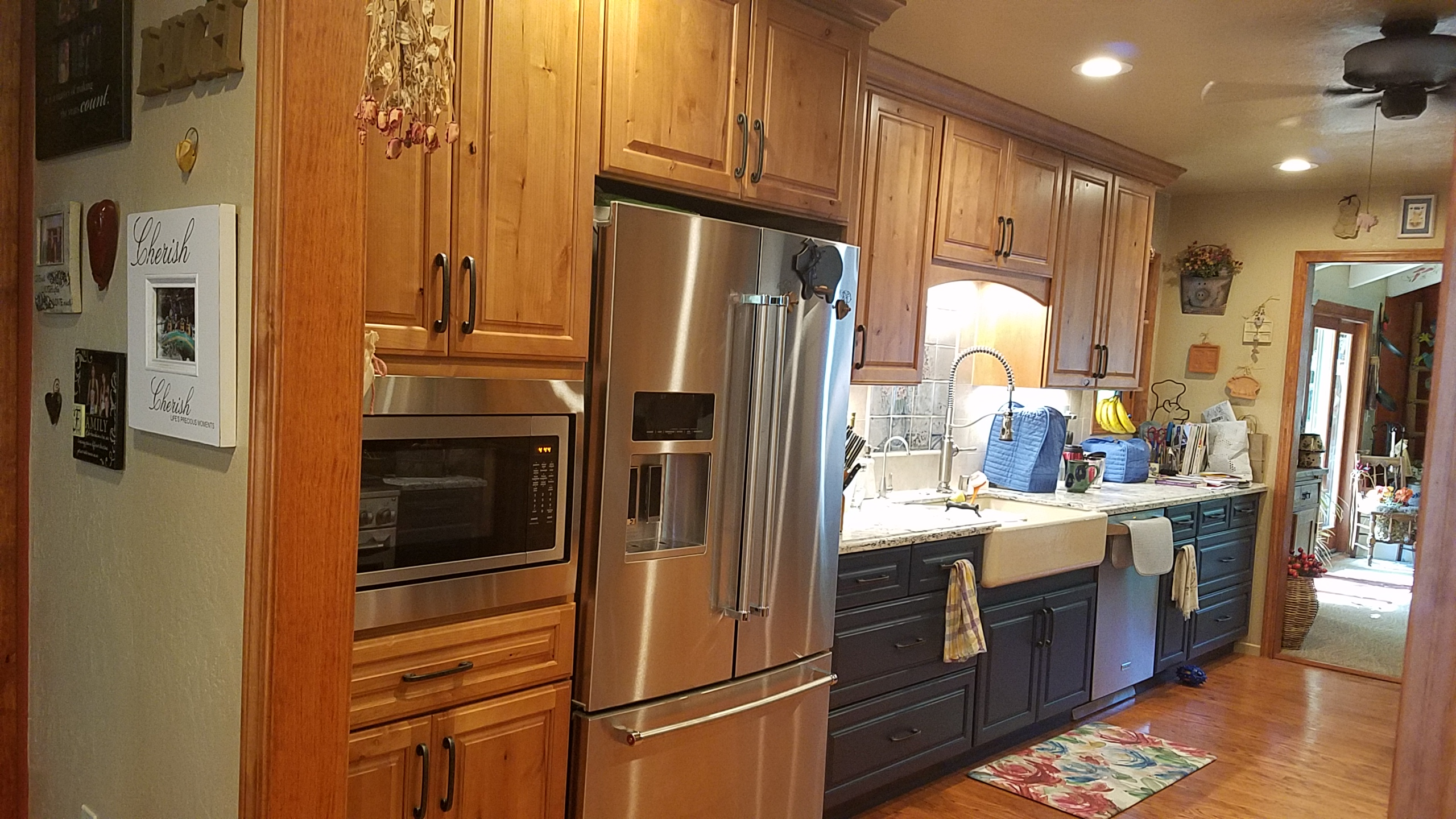 Country style cabinets, microwave and refridgerator