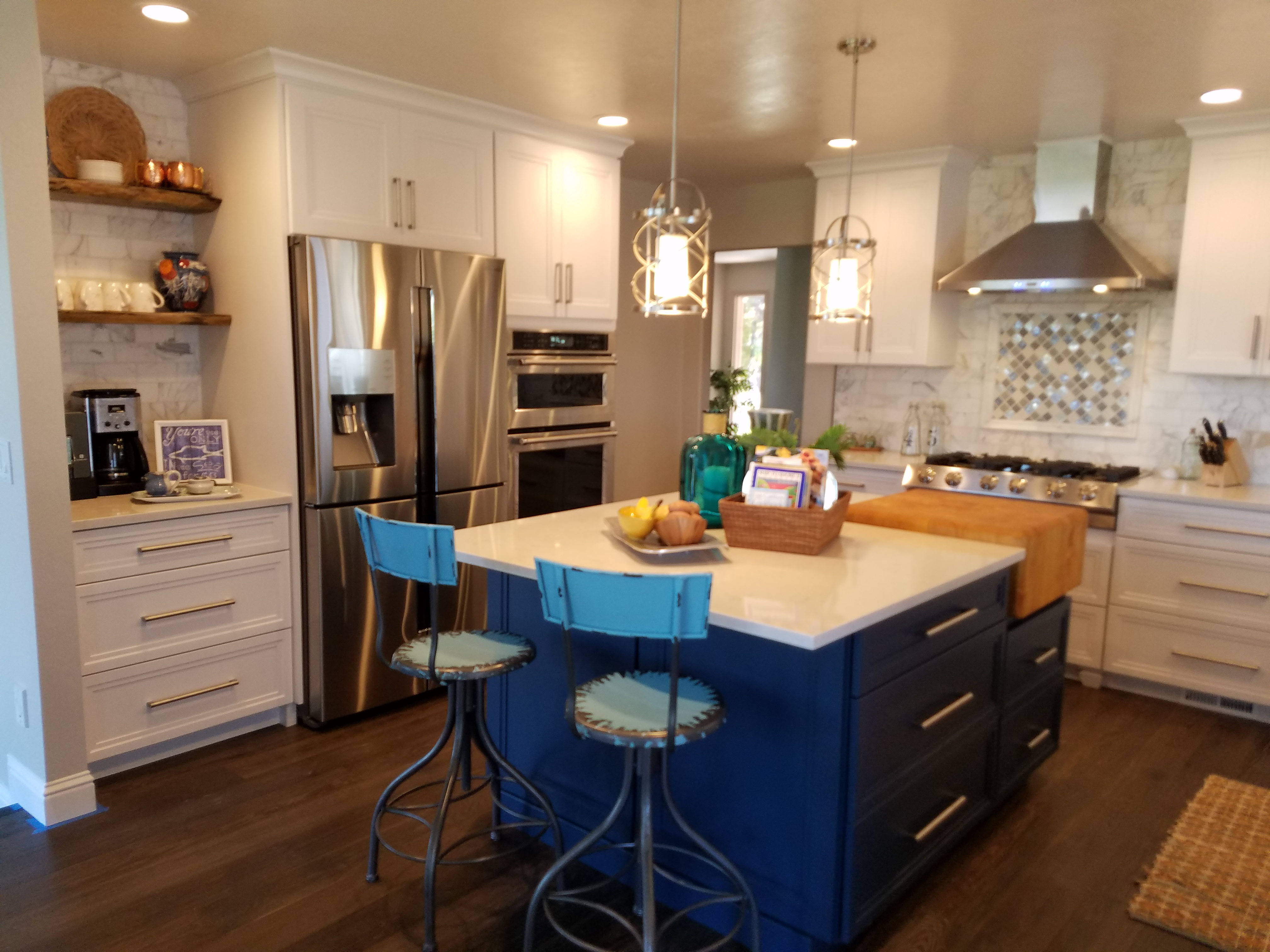White cabinets and counter tops, stainless fridge and oven
