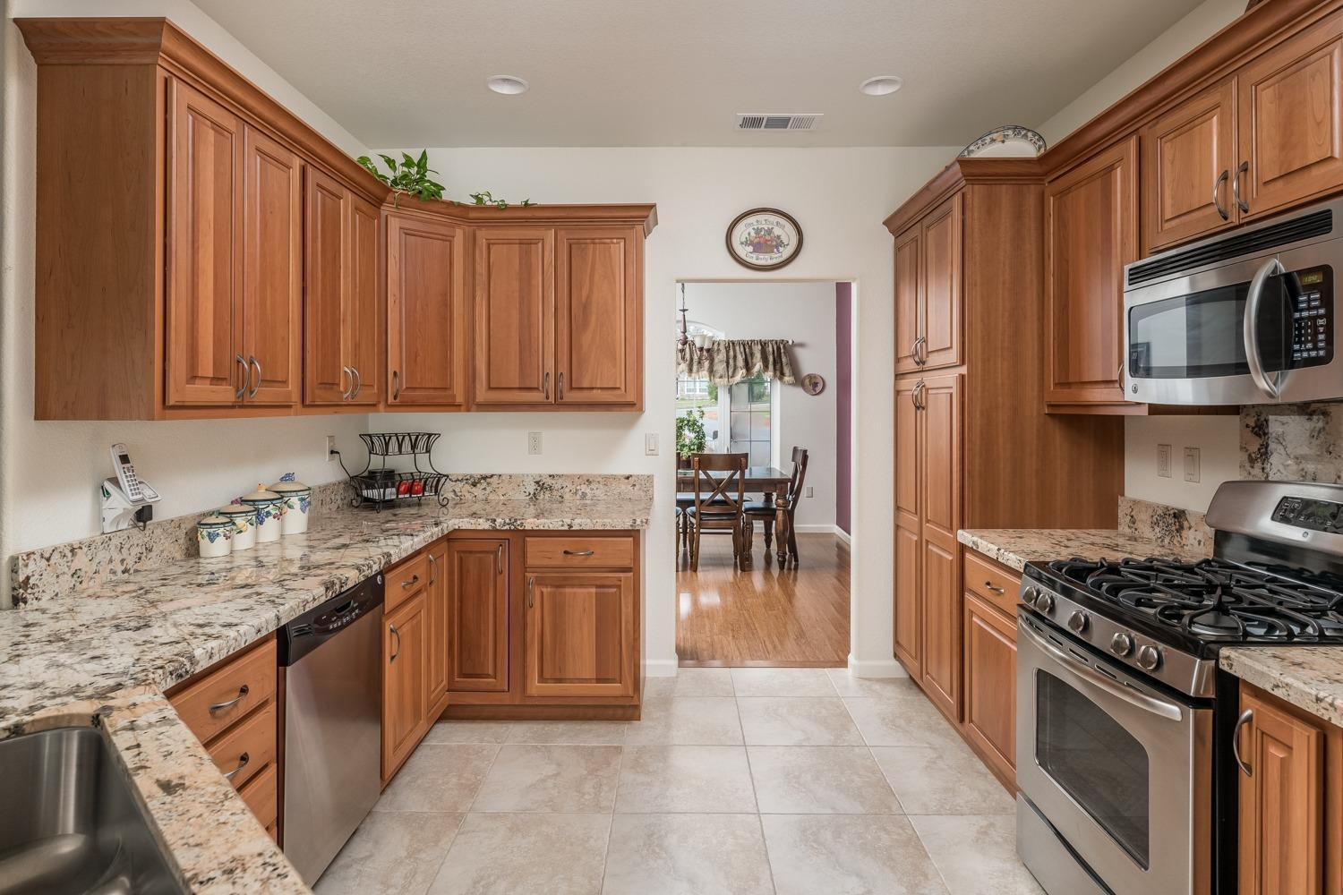 Light brown kitchen cabinets and granite counter