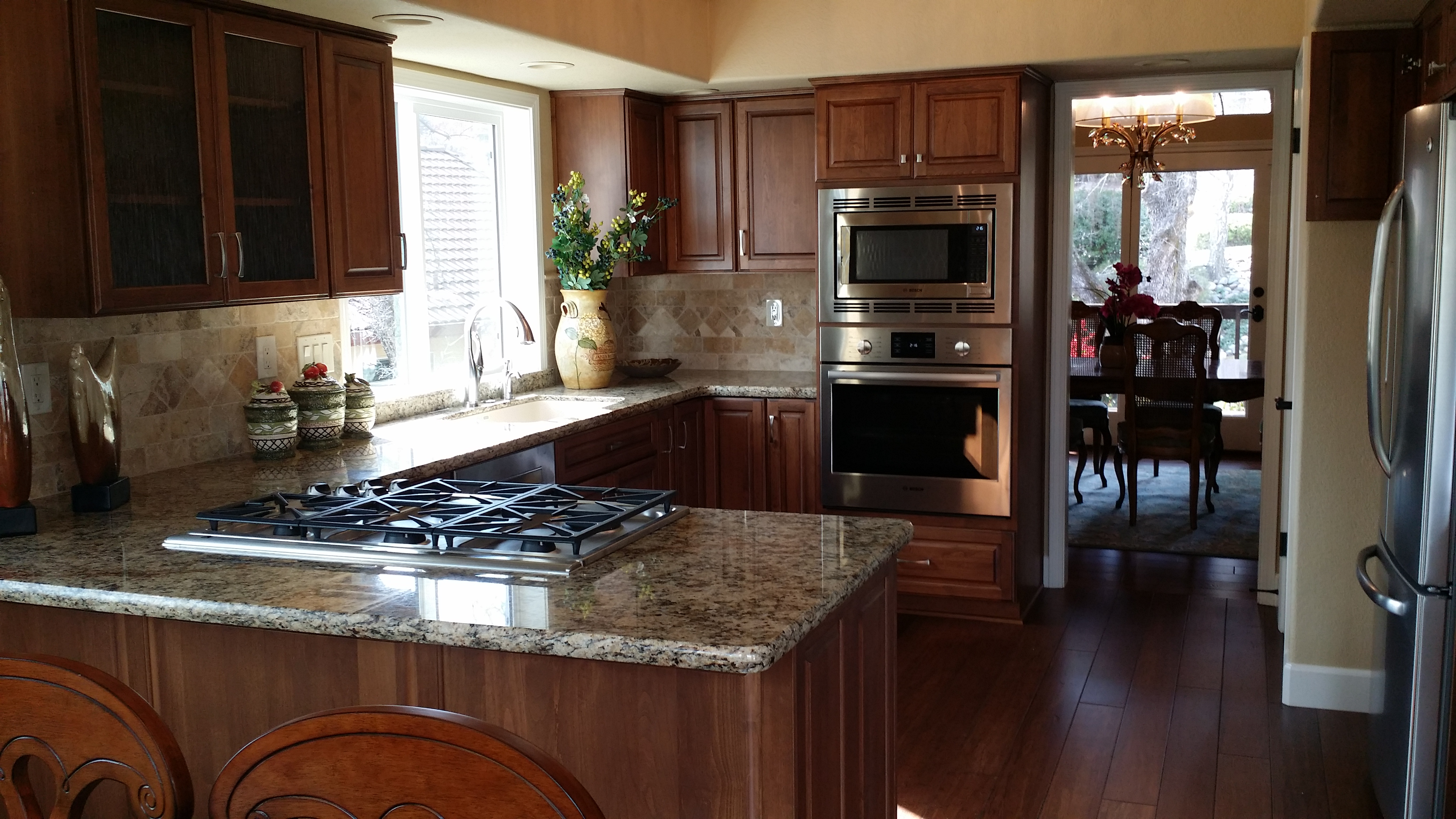 counter top range, light brown cabinets and granite counter top