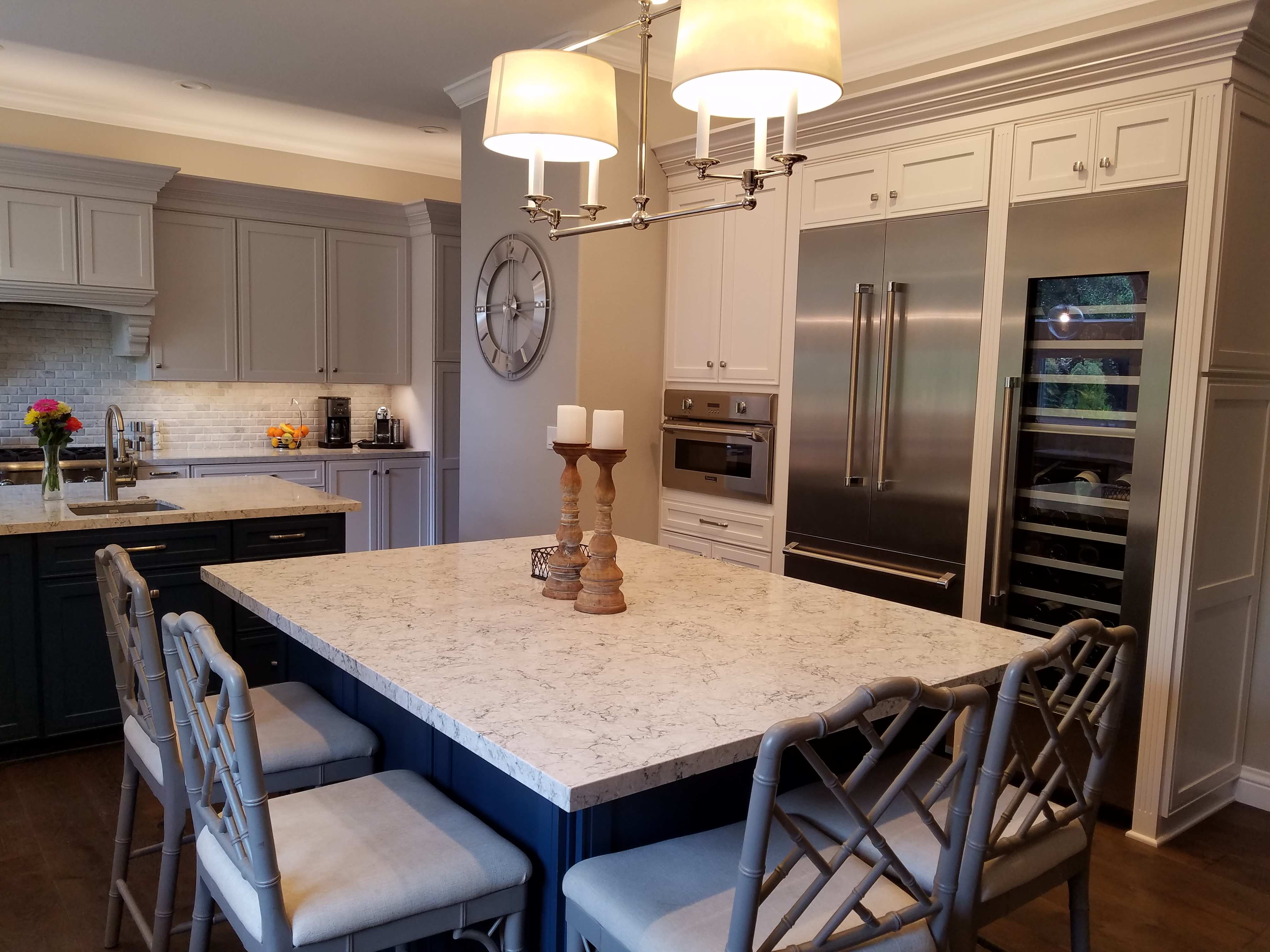 White marble dining room table, stainless fridge in background