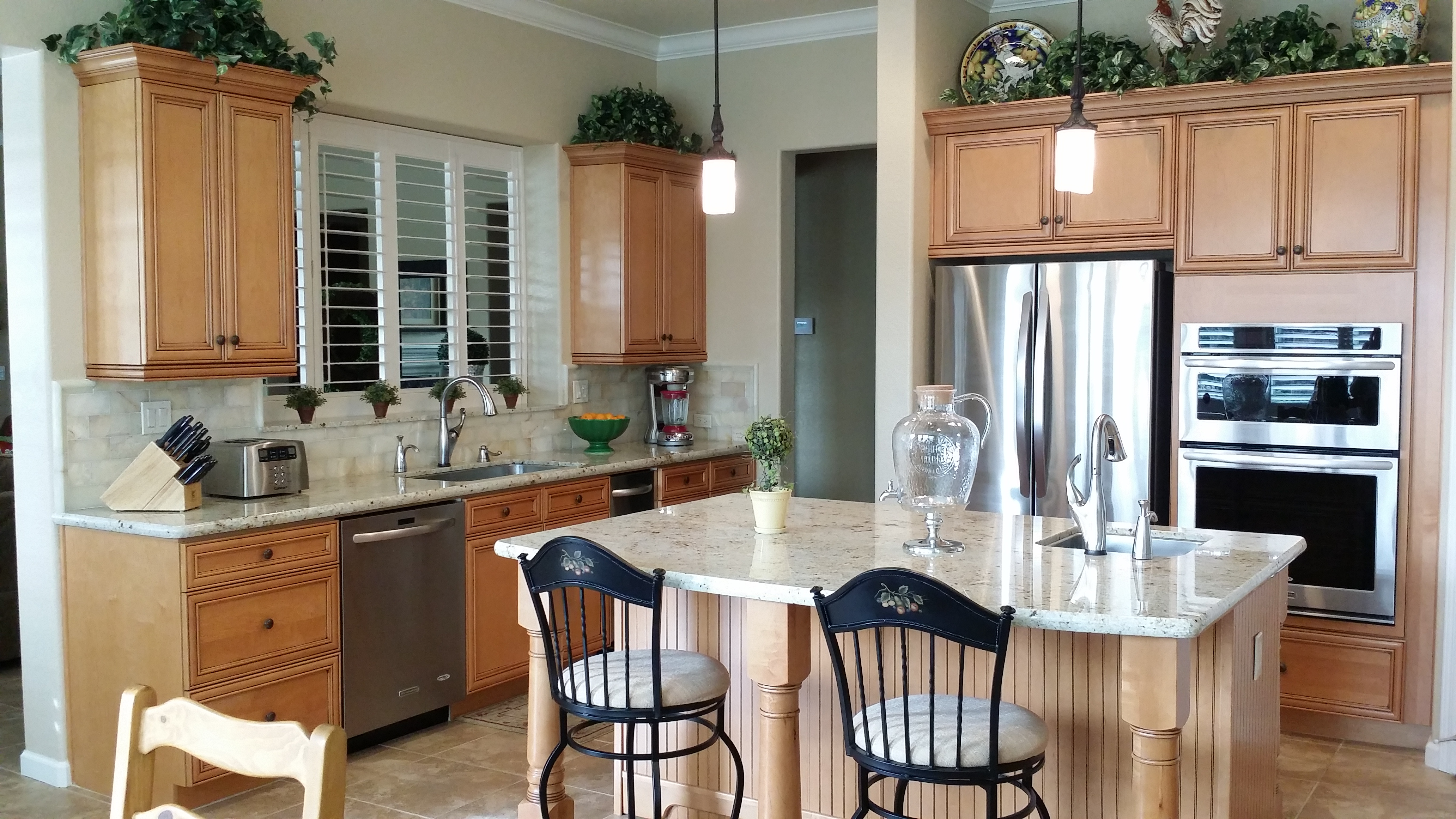 Traditional kitchen with light brown cabinets and white counters