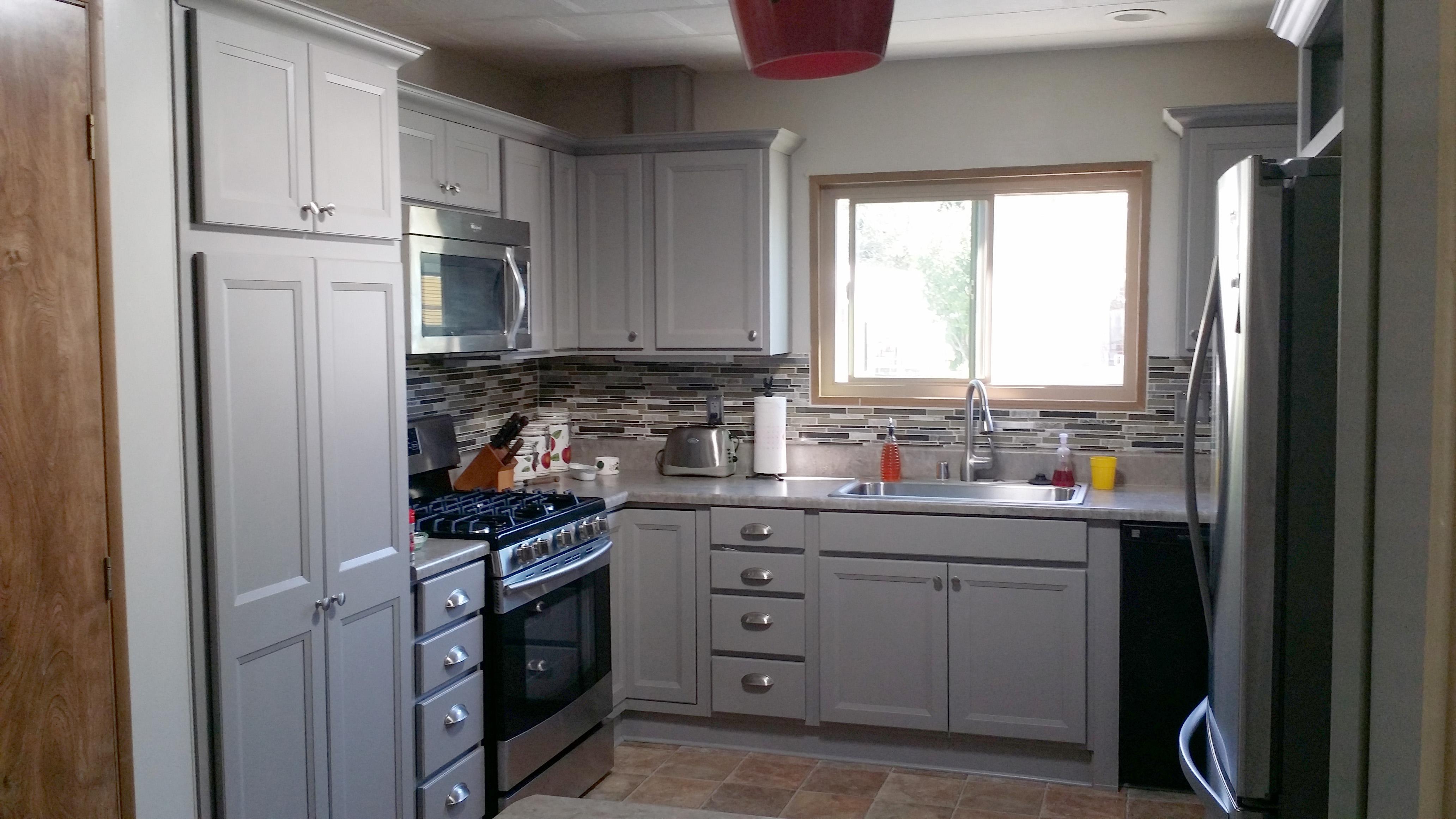 Range and cabinets, light grey.