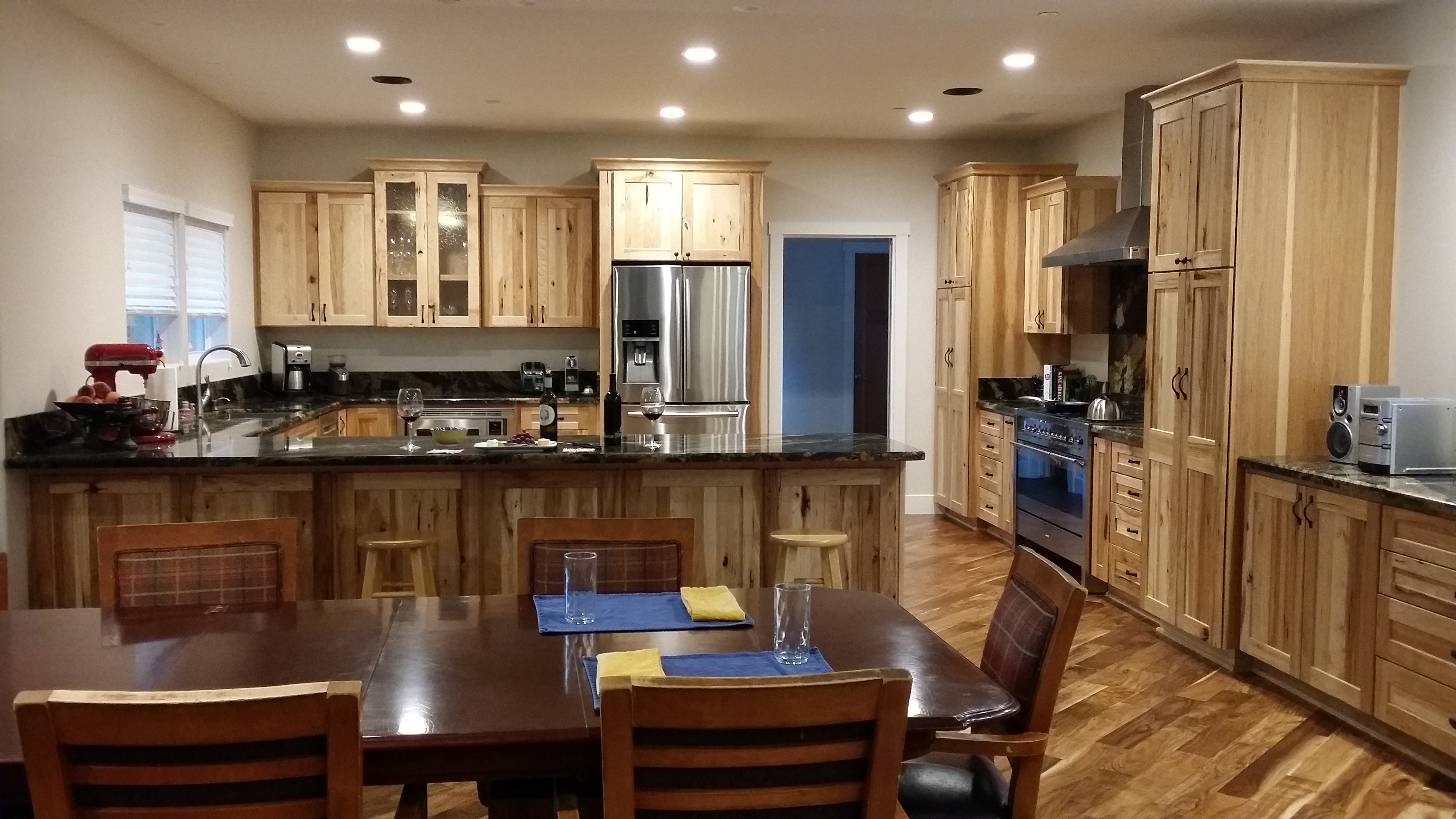 Craftsman kitchen, distressed wood cabinets and black countertops