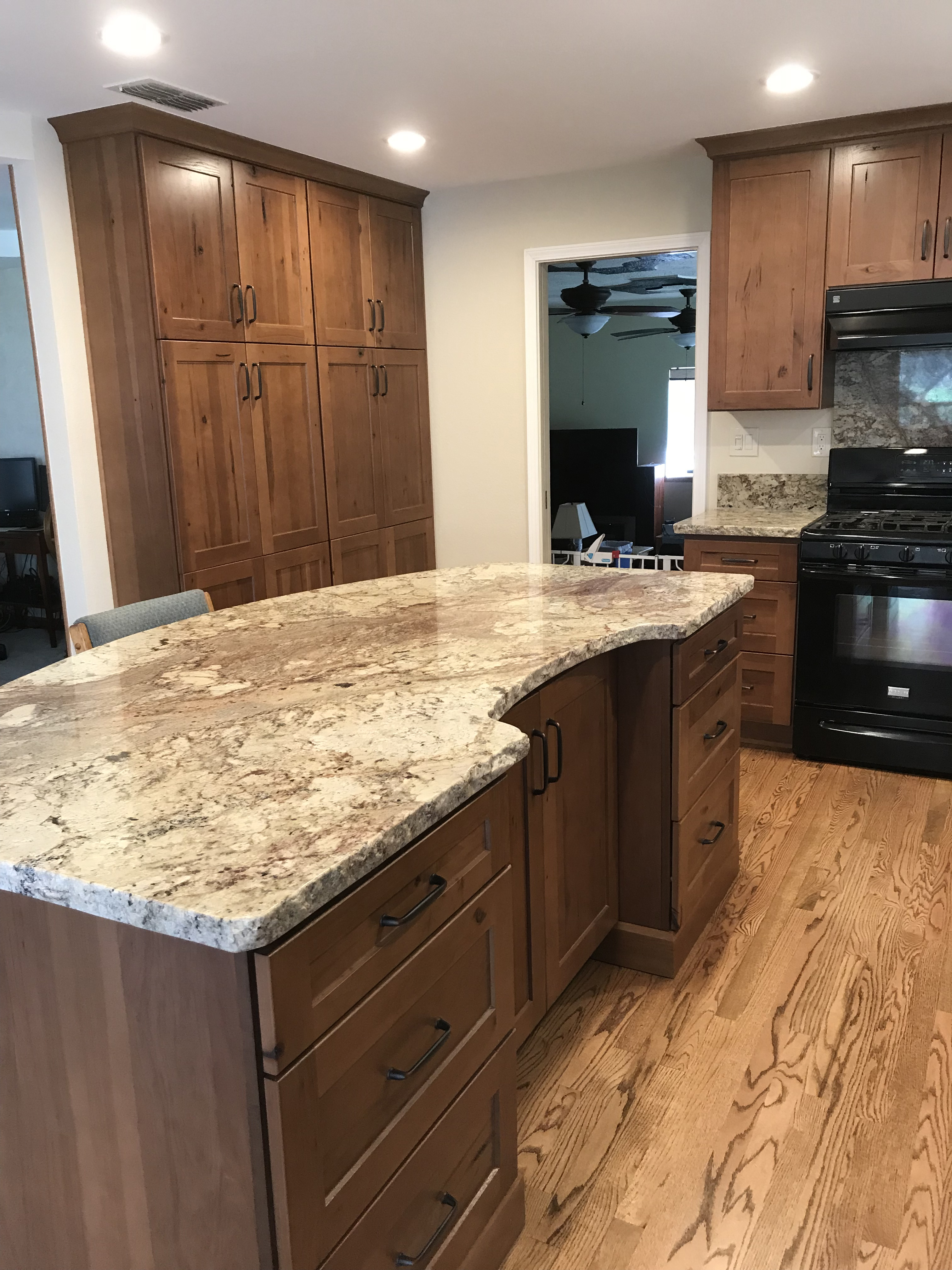 Dark brown island with light marble counter top