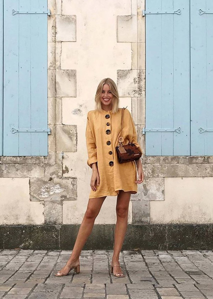 Stefansson Shines in pale yellow mid dress