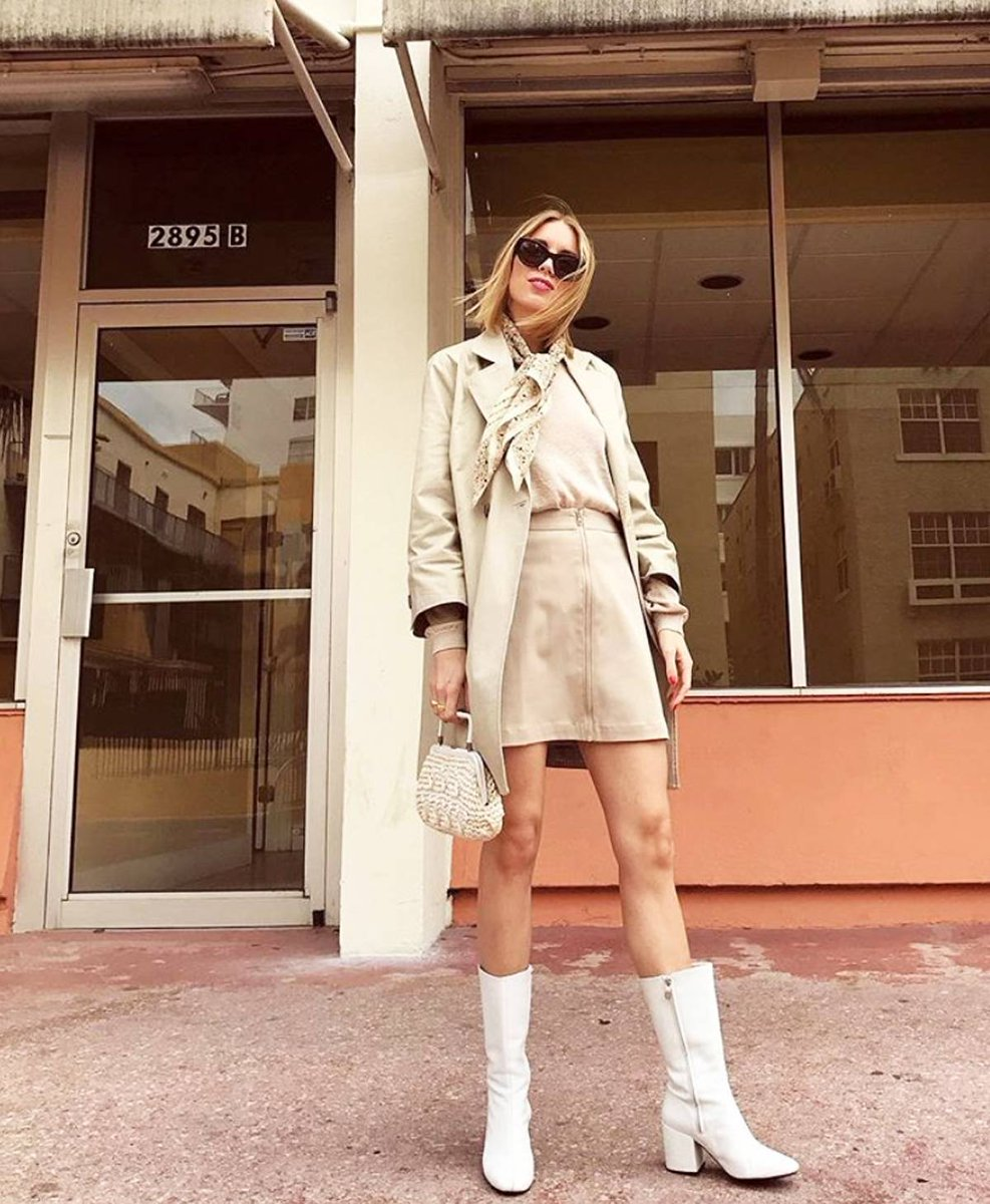 Stefansson Shines in beige trench, skirt and pale crimped top
