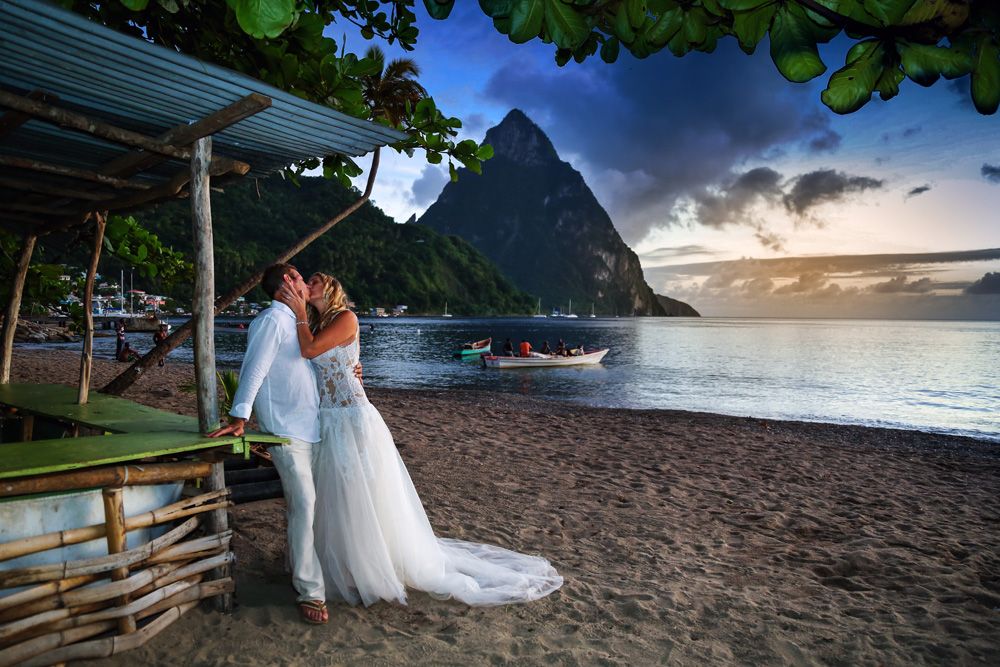 wedding day kiss in the sunset