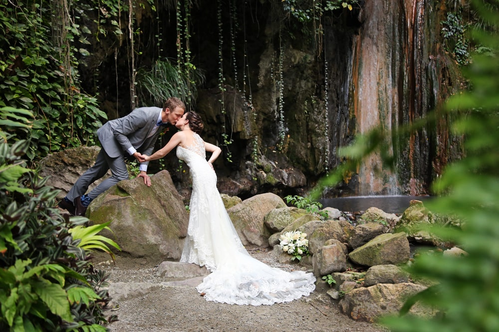 wedding day kiss by waterfall