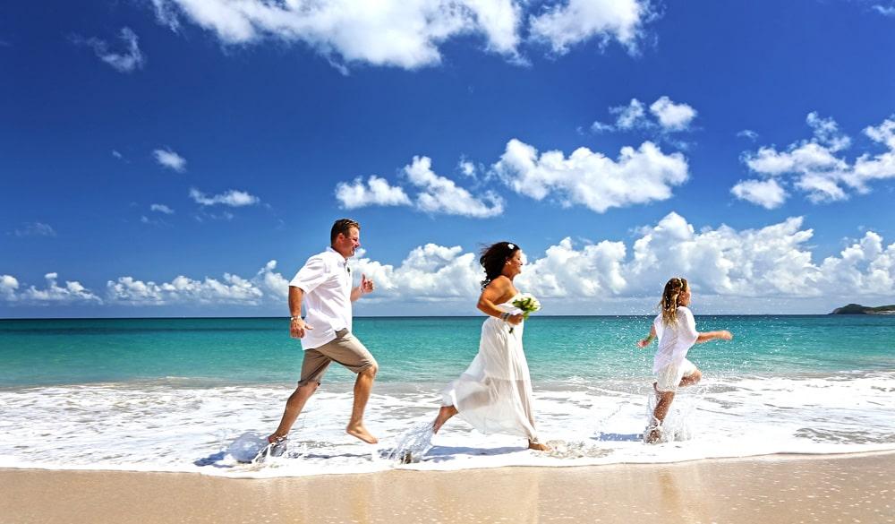 wedding family running on beach