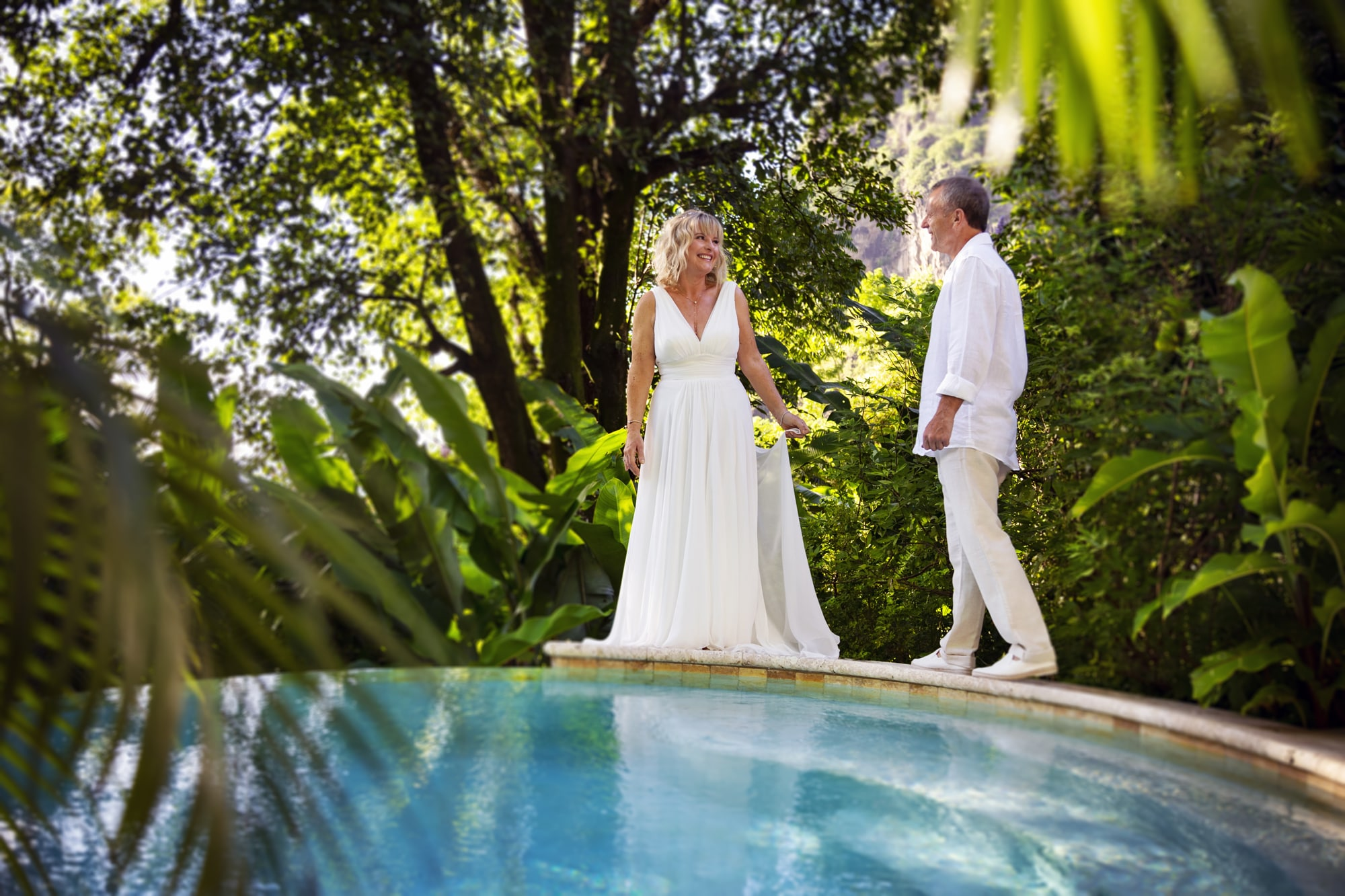 Wedding couple by the pool