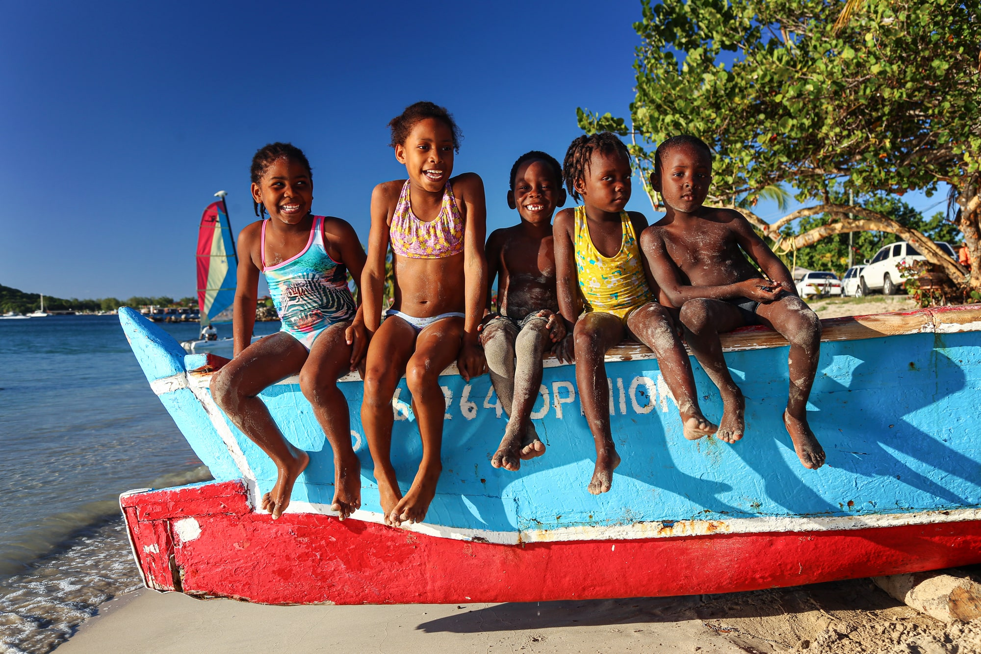 Kids on a boat in St. Lucia, Caribbean
