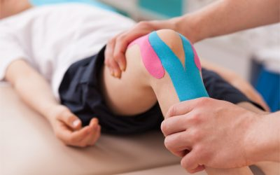 A young child's being bent as part of therapy.