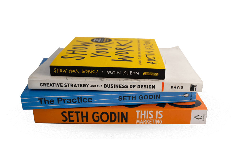 stack of recommended books on strategy & execution