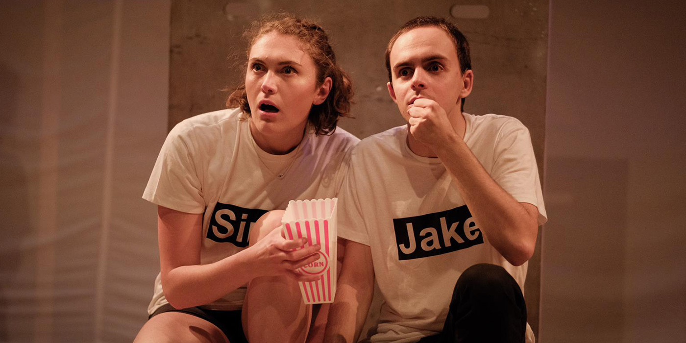 male and female actors performing with popcorn