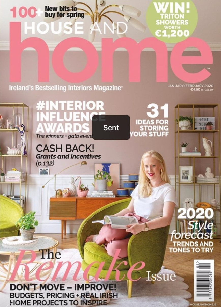 house and home magazine cover with smiling female in brightly lit, apartment