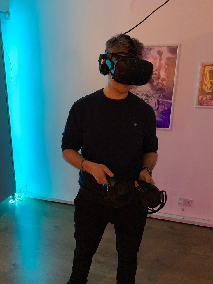 man playing with virtual reality headset
