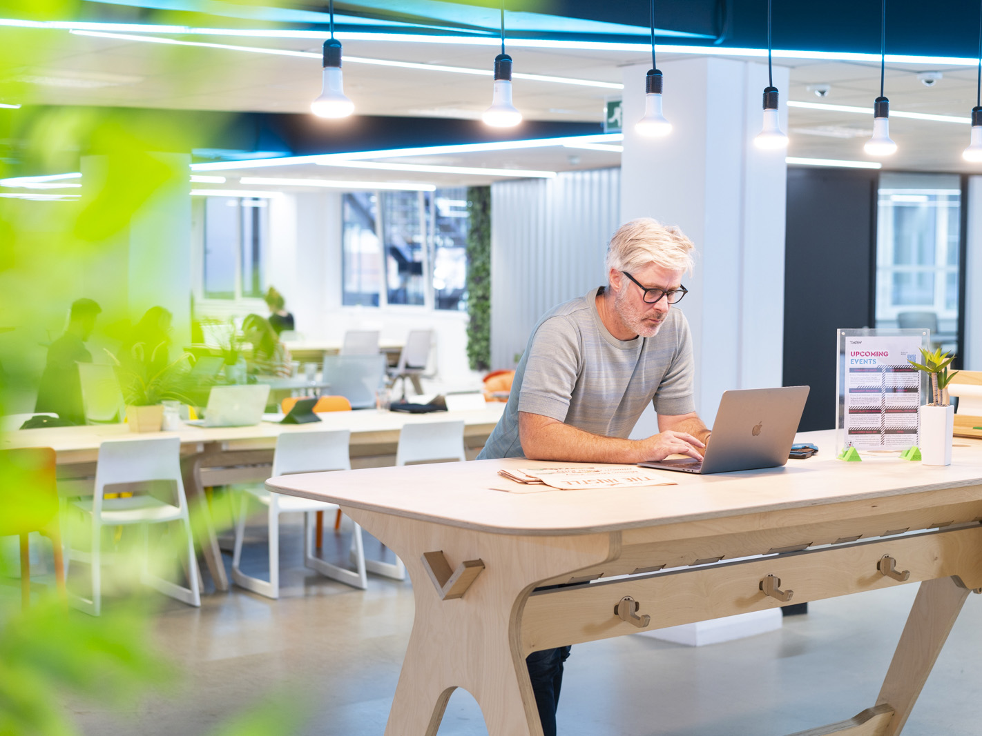 Man working standing desk coworking space