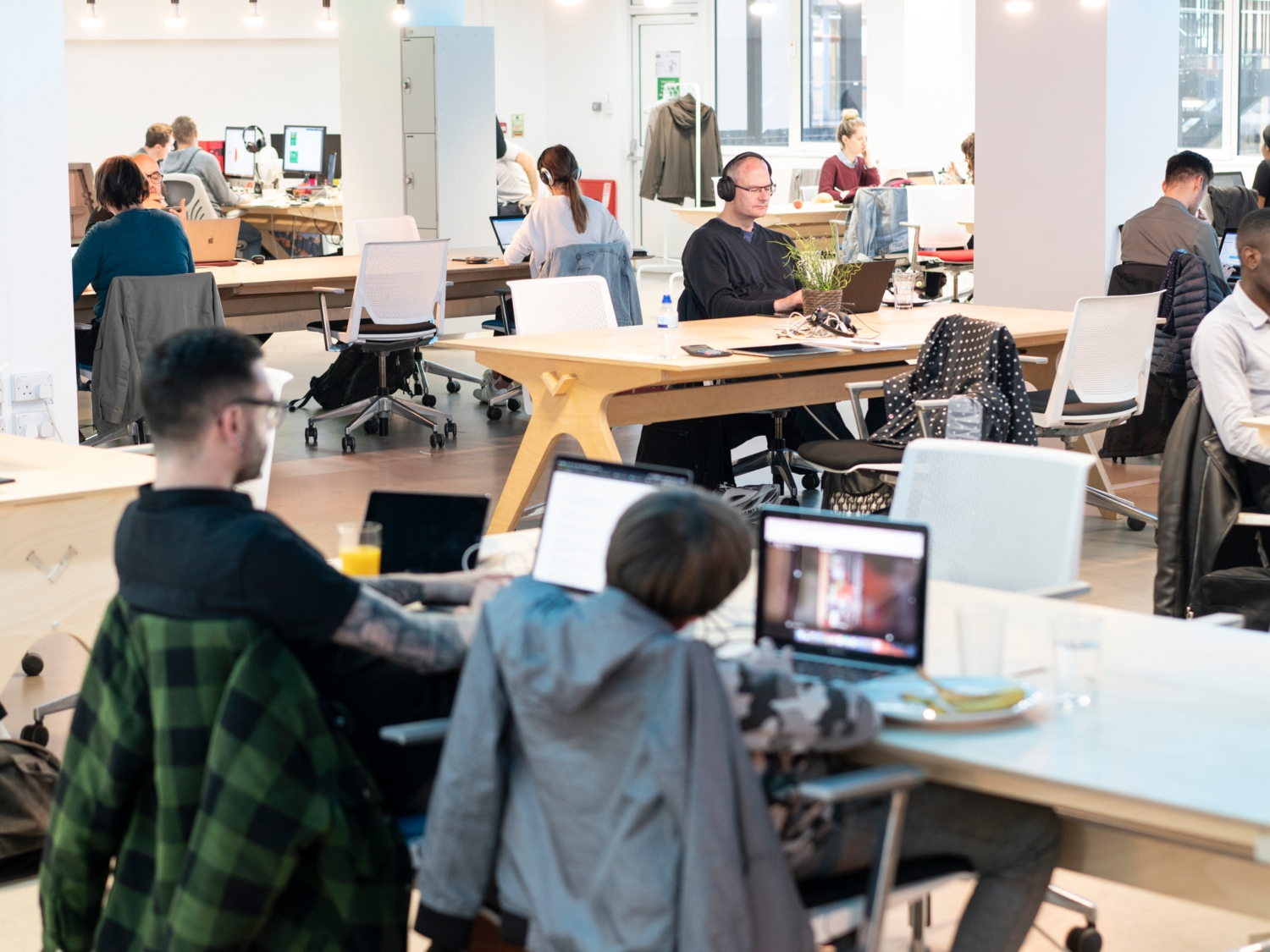 populated desks in coworking space