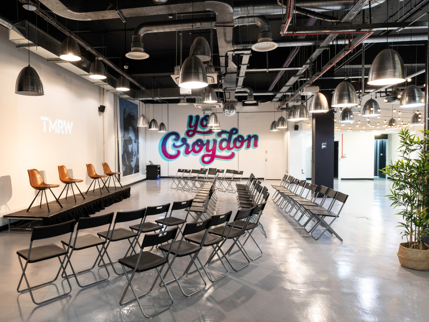Large event space with Yo Croydon mural and seminar layout